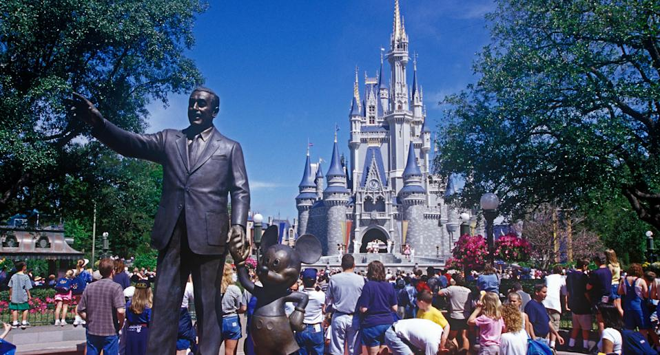 A statue of Walt Disney stands at the front of Disney World. (Photo: Mira/Alamy Stock Photo)