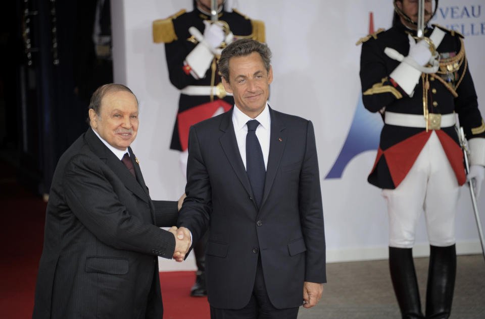 FILE - In this Friday, May 27, 2011, file photo, French President Nicolas Sarkozy, right, welcomes Algerian President Abdelaziz Bouteflika prior to a round table meeting at the G8 summit in Deauville, France. Former Algerian President Bouteflika, who fought for independence from France in the 1950s and 1960s and was ousted amid pro-democracy protests in 2019 after 20 years in power, has died at age 84, state television announced Friday, Sept. 17, 2021. (Damien Meyer/Pool Photo via AP)