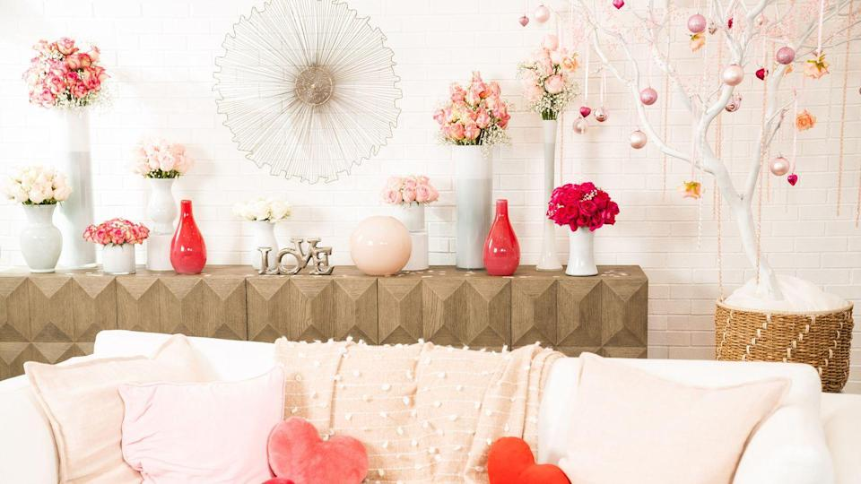 """<p>Convince everyone that you're ready for Valentine's Day with this living room setup, complete with heart-shaped pillows, flower vases, and a holiday-appropriate tree.</p><p><a class=""""link rapid-noclick-resp"""" href=""""https://www.hallmarkchannel.com/hallmark-channel-virtual-backgrounds-love"""" rel=""""nofollow noopener"""" target=""""_blank"""" data-ylk=""""slk:DOWNLOAD HERE"""">DOWNLOAD HERE</a></p><p><strong>RELATED:</strong> <a href=""""https://www.goodhousekeeping.com/holidays/valentines-day-ideas/g30174656/valentines-day-decor-ideas/"""" rel=""""nofollow noopener"""" target=""""_blank"""" data-ylk=""""slk:Sweet Valentine's Day Decorations for the Rest of Your Home"""" class=""""link rapid-noclick-resp"""">Sweet Valentine's Day Decorations for the Rest of Your Home</a></p>"""