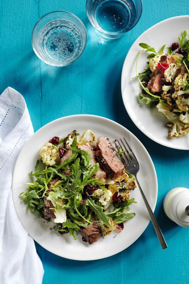 """<p>Seared sirloin steak, a bed of fresh arugula, and cauliflower. What could possibly be tastier? If you're still not convinced, the honey-lemon vinaigrette is a true delight. </p><p><em><a href=""""https://www.womansday.com/food-recipes/food-drinks/recipes/a57720/steak-salad-honey-lemon-vinaigrette-recipe/"""" rel=""""nofollow noopener"""" target=""""_blank"""" data-ylk=""""slk:Get the Steak Salad with Honey-Lemon Vinaigrette recipe."""" class=""""link rapid-noclick-resp"""">Get the Steak Salad with Honey-Lemon Vinaigrette recipe. </a></em></p>"""