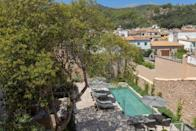 """<p>Boutique hotel <a href=""""https://go.redirectingat.com?id=127X1599956&url=https%3A%2F%2Fwww.booking.com%2Fhotel%2Fes%2Fboutique-can-auli-pollenca.en-gb.html%3Faid%3D2070929%26label%3Dmallorca-hotels&sref=https%3A%2F%2Fwww.redonline.co.uk%2Ftravel%2Fg37570714%2Fmallorca-hotels%2F"""" rel=""""nofollow noopener"""" target=""""_blank"""" data-ylk=""""slk:Can Auli"""" class=""""link rapid-noclick-resp"""">Can Auli</a> is a converted 17th century manor house in the heart of Pollensa's town for a luxurious retreat to the north of Mallorca. Its decor is a stylish blend of modern rustic using local hand-woven fabrics alongside contemporary pieces to enhance the historic character of the building. Wooden beams, high ceilings and exposed stone walls create a homely atmosphere with all modern comforts.</p><p>There are 21 rooms - some with their own private terrace with views of the Sierra Tramuntana. A restaurant and gastro bar serves breakfast and snacks throughout the day, and you can while away yours days by the outdoor swimming pool with a bar and garden. The hotel also follows a sustainable policy, reducing the use of plastics by sourcing alternative, recyclable products where possible.</p><p><a class=""""link rapid-noclick-resp"""" href=""""https://go.redirectingat.com?id=127X1599956&url=https%3A%2F%2Fwww.booking.com%2Fhotel%2Fes%2Fboutique-can-auli-pollenca.en-gb.html%3Faid%3D2070929%26label%3Dmallorca-hotels&sref=https%3A%2F%2Fwww.redonline.co.uk%2Ftravel%2Fg37570714%2Fmallorca-hotels%2F"""" rel=""""nofollow noopener"""" target=""""_blank"""" data-ylk=""""slk:CHECK AVAILABILITY"""">CHECK AVAILABILITY</a></p>"""