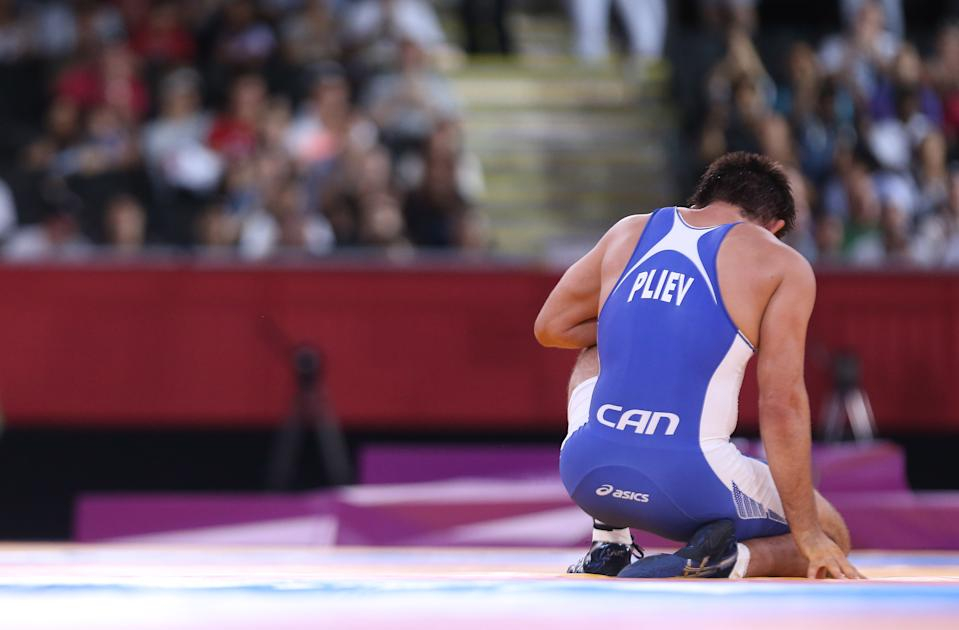 Khetag Pliev lose his repechage match to Russian Kurban Kurbanov.