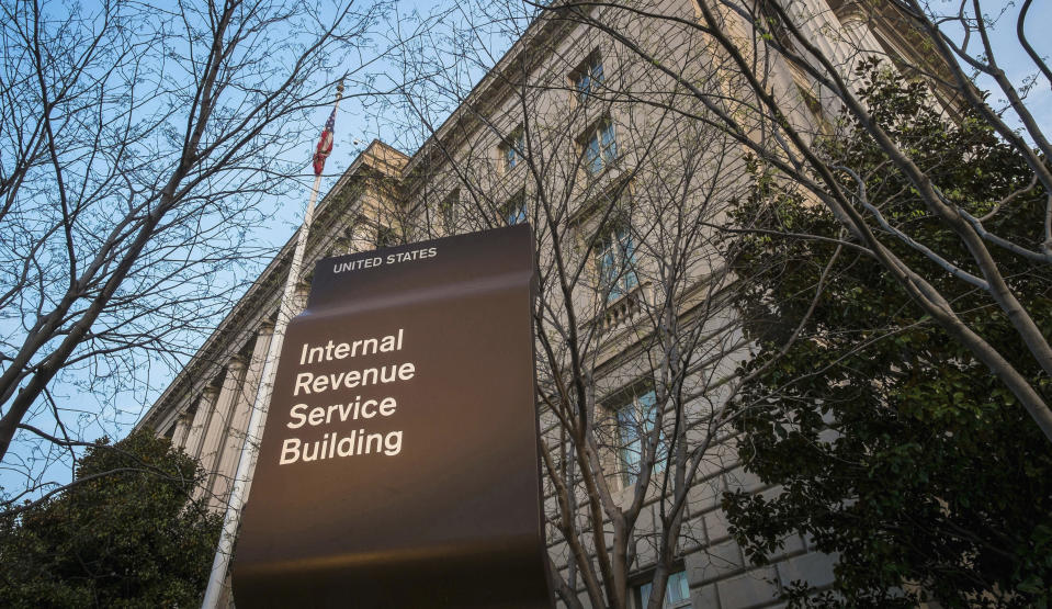 FILE - This April 13, 2014, file photo shows the Internal Revenue Service (IRS) headquarters building in Washington. On Friday, April 17, 2020, The Associated Press reported on stories circulating online incorrectly asserting that one can call a 1-800 number and enter your social security number to check on the status of the relief check the federal government is sending as part of the $2.2 trillion economic recovery bill in response to the coronavirus. The IRS isn't currently accepting calls by phone because of the coronavirus. The IRS has warned Americans of scam artists who might try to swindle you out of your relief check through fraudulent emails, text messages, websites or social media posts that request your banking or personal information. (AP Photo/J. David Ake, File)
