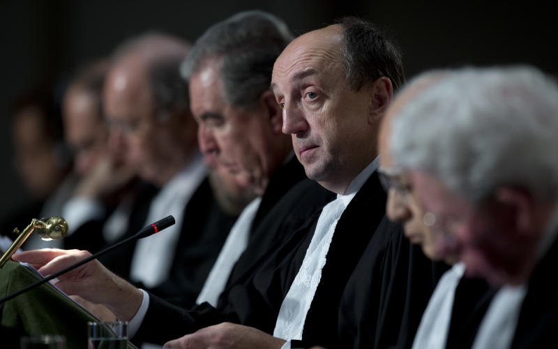 Presiding judge Tomka, third from right, opens the hearings in a dispute between Peru and Chile over the two countries' maritime boundary at the International Court of Justice in The Hague, Monday Dec. 3, 2012. (AP Photo/Peter Dejong)
