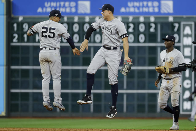 New York Yankees second baseman Gleyber Torres, left, and right fielder Aaron Judge celebrate after there win against the Houston Astros in Game 1 of baseball's American League Championship Series Saturday, Oct. 12, 2019, in Houston. (AP Photo/Matt Slocum)