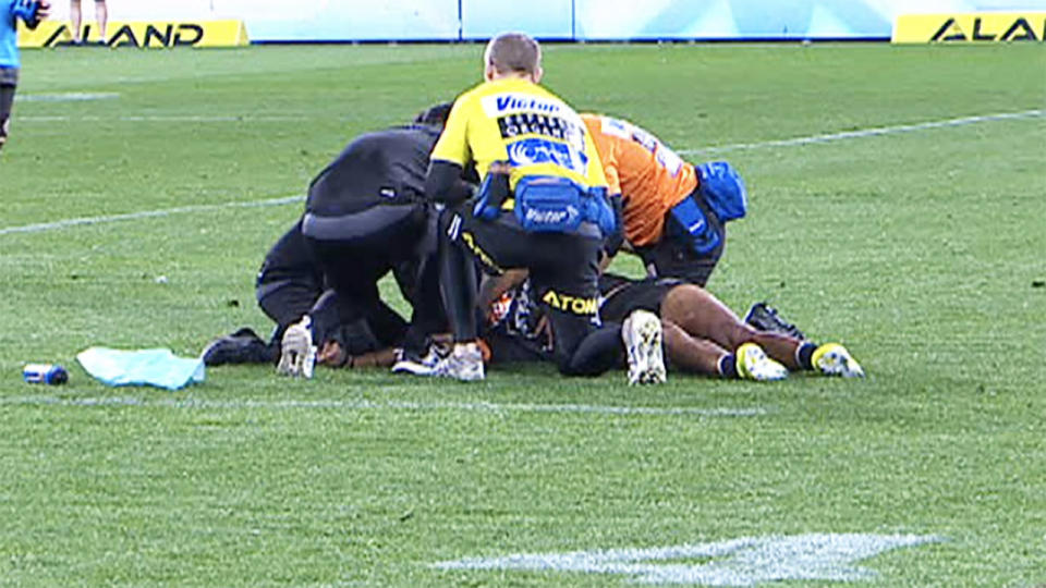 Michael Chee Kam, pictured here convulsing on the field after being knocked out.