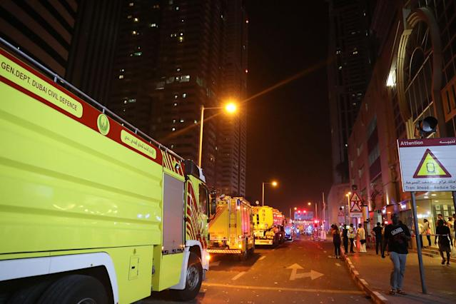 <p>Fire trucks arrive after a blaze started at the 1,105 foot tall Torch tower skyscraper on August 4, 2017 in Dubai. (Photo: Karim Sahib/AFP/Getty Images) </p>