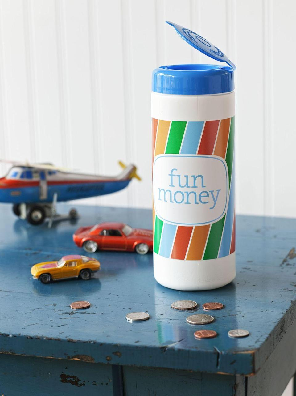 """<p>Want to teach your kids that every penny counts? Make a coin bank out of an empty disinfectant wipes container. Clear the outside of the container and attach your own """"Fun Money"""" label. </p>"""