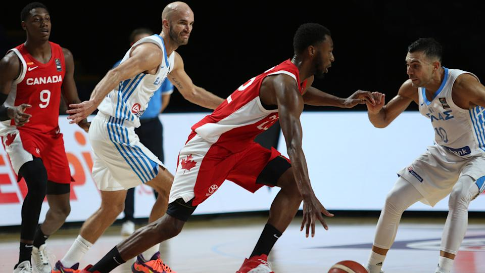 Canada's Andrew Wiggins looks for an open man as Greece players try to steal the ball. (THE CANADIAN PRESS/Chad Hipolito)