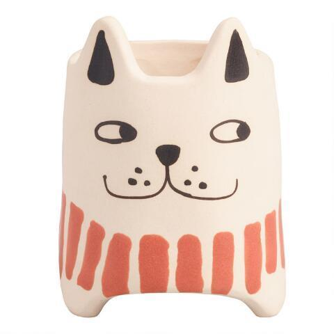 """<br><h2>Cream Dog Ceramic Planter<br></h2><br>This pup looks like he has a secret that we'll never know, but we do know that he would look great on a windowsill or on your WFH desk. <br><br><em>Shop</em> <strong><em><a href=""""http://worldmarket.com"""" rel=""""nofollow noopener"""" target=""""_blank"""" data-ylk=""""slk:Cost Plus World Market"""" class=""""link rapid-noclick-resp"""">Cost Plus World Market</a></em></strong><br><br><br><br><strong>Cost Plus World Market</strong> Cream Dog Ceramic Planter, $, available at <a href=""""https://go.skimresources.com/?id=30283X879131&url=https%3A%2F%2Ffave.co%2F2WXAEa8"""" rel=""""nofollow noopener"""" target=""""_blank"""" data-ylk=""""slk:Cost Plus World Market"""" class=""""link rapid-noclick-resp"""">Cost Plus World Market</a>"""