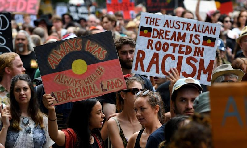 Protesters march during the Invasion Day rally in Melbourne, Australia, 26 January 2020.