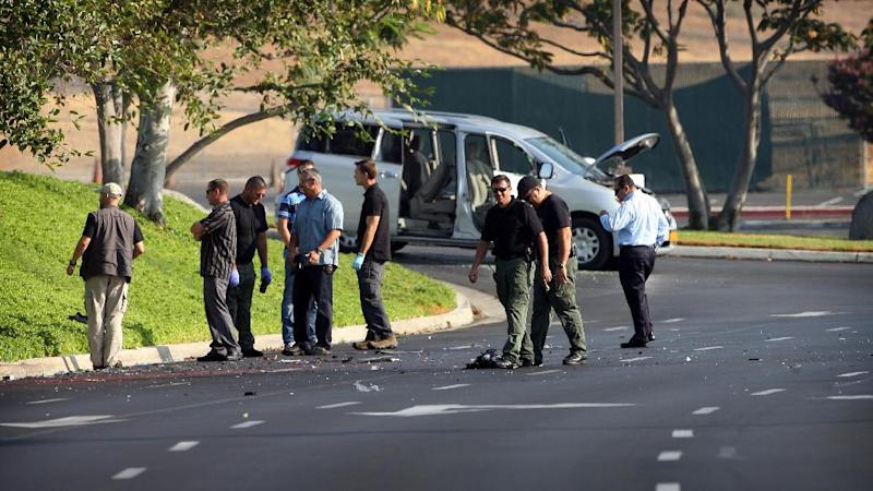 Investigators examine a van that was driven by the former TSA worker, Nna Alpha Onuoha, 29, when he was arrested on suspicion of making threats related to the anniversary of the 9/11 terriorist attacks, on Wednesday, Sept. 11, 2013, in Riverside, Calif. Alpha Onuoha, 29, was arrested shortly before midnight Tuesday east of Los Angeles in Riverside, and he remained in custody on suspicion of making threats pending additional investigation. (AP Photo/The Press-Enterprise, Kurt Miller) NO SALES; MAGS OUT; MANDATORY CREDIT