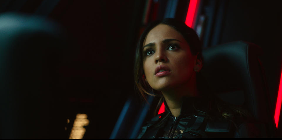 """This image released by Warner Bros. Entertainment shows Eiza Gonzalez in a scene from """"Godzilla vs. Kong."""" (Warner Bros. Entertainment via AP)"""