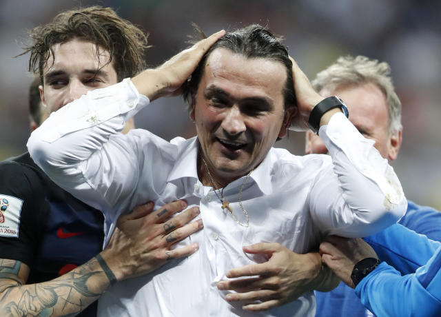Croatia head coach Zlatko Dalic celebrates after his team advanced to the final during the semifinal match between Croatia and England at the 2018 soccer World Cup in the Luzhniki Stadium in Moscow, Russia, Wednesday, July 11, 2018. (AP Photo/Frank Augstein)