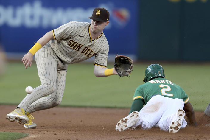 Oakland Athletics' Starling Marte, right, slides safe into second with a stolen base as San Diego Padres' Jake Cronenworth wait for the throw during the third inning of a baseball game in Oakland, Calif., Tuesday, Aug. 3, 2021. (AP Photo/Jed Jacobsohn)