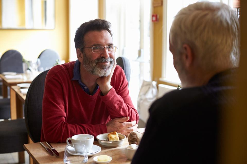 older gay white man having coffee across from other man