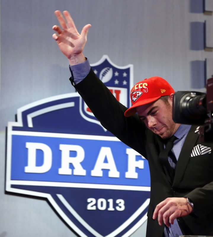 Fisher from Central Michigan University walks onstage after being selected by Kansas City Chiefs as first overall pick in the 2013 NFL Draft in New York