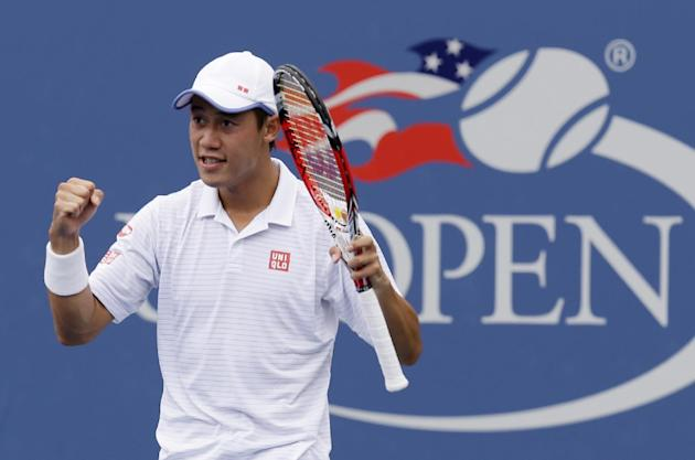 Kei Nishikori, of Japan, reacts after defeating Leonardo Mayer, of Argentina, during the third round. (AP Photo/Seth Wenig)
