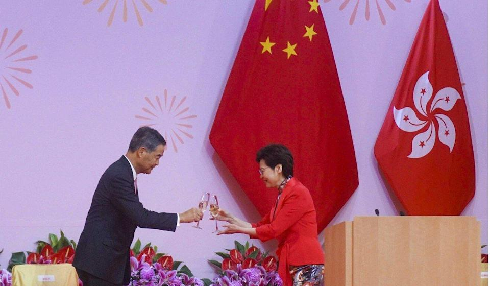 Hong Kong Chief Executive Carrie Lam and former city leader Leung Chun-ying toast each other at an official National Day reception on Friday. Winson Wong