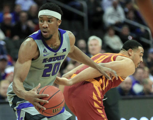 Kansas State forward Xavier Sneed (20) spins away from Iowa State guard Talen Horton-Tucker (11) during the first half of an NCAA college basketball game in the semifinals of the Big 12 Conference tournament in Kansas City, Mo., Friday, March 15, 2019. (AP Photo/Orlin Wagner)