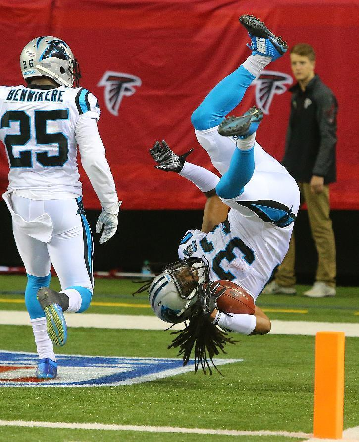Carolina Panthers safety (33) Tre Boston does a victory flip into the end zone after intercepting Atlanta Falcons quarterback Matt Ryan and returning the ball for a touchdown during the second half of an NFL football game Sunday, Dec. 28, 2014, in Atlanta. The Panthers won 34-3. (AP Photo/Atlanta Journal Constitution, Curtis Compton)