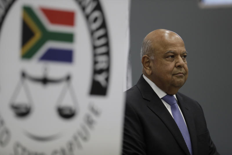 Public Enterprises Minister Pravin Gordhan appears at the judicial commission of inquiry into state capture in Johannesburg, South Africa. Monday, Nov. 19, 2018. Gordhan is expected to reveal details surrounding former president Jacob Zuma's trillion-rand nuclear procurement campaign as well as other corruption prcatices. (AP Photo/Themba Hadebe)