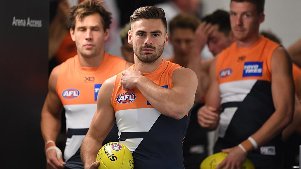 Stephen Coniglio, pictured here leading the Giants out for their match against Carlton.