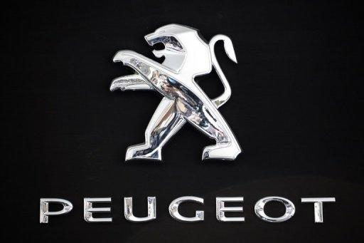 PSA Peugeot Citroen announced it had suffered a first half net loss of 819 million euros