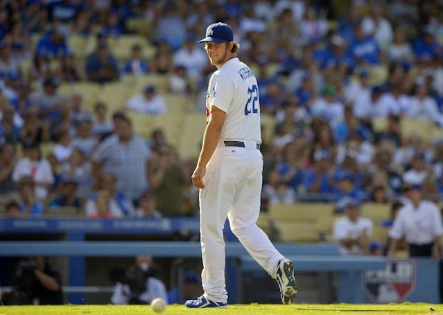 Los Angeles Dodgers starting pitcher Clayton Kershaw looks on after striking out the side during the first inning of their baseball game against the Tampa Bay Rays, Sunday, Aug. 11, 2013, in Los Angeles. (AP Photo/Mark J. Terrill)