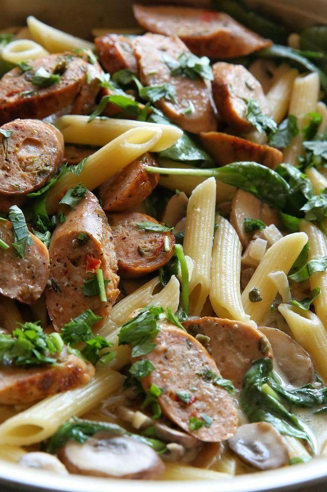 """<p>Creamy, garlicky pasta is what dreams are made of. This recipe calls for chicken sausage (Heck and Richmond do great varieties), but opt for pork sausages if you prefer. If using pork sausages, make sure they're cooked properly (around 10-12 minutes in the pan).</p><p>Get the <a href=""""https://www.delish.com/uk/cooking/recipes/a29571352/chicken-sausage-and-mushroom-penne-recipe/"""" rel=""""nofollow noopener"""" target=""""_blank"""" data-ylk=""""slk:Sausage & Mushroom Penne"""" class=""""link rapid-noclick-resp"""">Sausage & Mushroom Penne</a> recipe.</p>"""