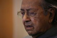 Malaysia's former Prime Minister Mahathir Mohamad reacts during a news conference in Putrajaya