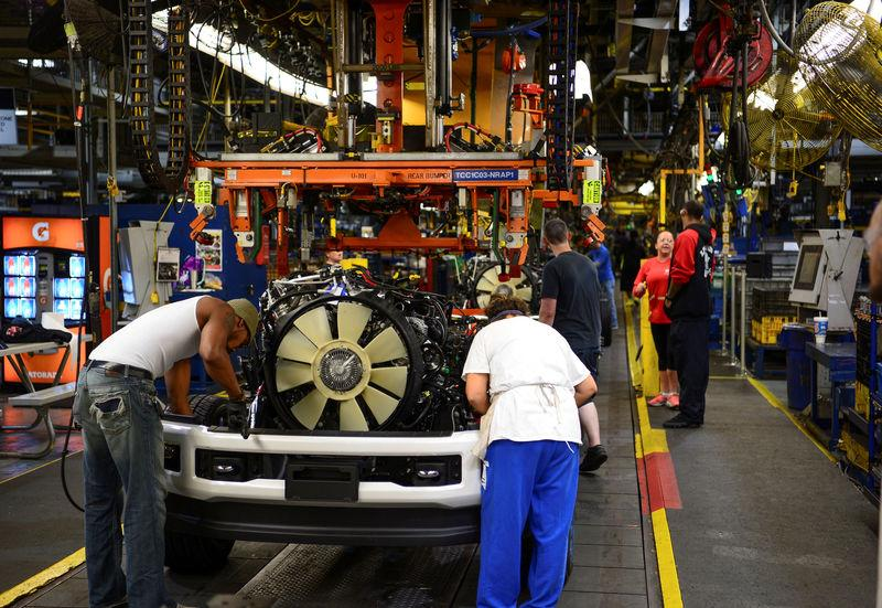 Workers assemble a Ford truck at the new Louisville Ford truck plant in Louisville