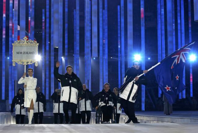 New Zealand's flag-bearer Adam Hallflag (R), leads his country's contingent during the opening ceremony of the 2014 Paralympic Winter Games in Sochi, March 7, 2014. REUTERS/Alexander Demianchuk (RUSSIA - Tags: OLYMPICS SPORT)