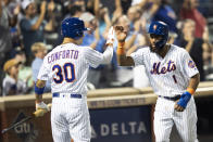 New York Mets' Amed Rosario (1) celebrates scoring with Michael Conforto (30) on a two run double by Pete Alonso during the seventh inning of a baseball game against the Cleveland Indians, Tuesday, Aug. 20, 2019, in New York. (AP Photo/Mary Altaffer)