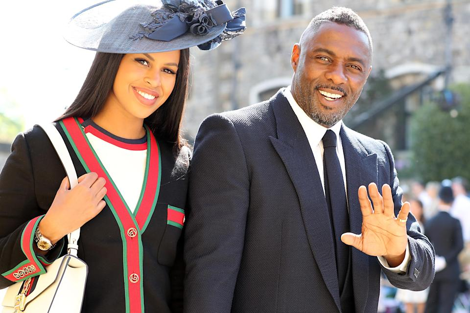 Idris Elba and Sabrina Dhowre arrive at St George's Chapel (Picture: PA)