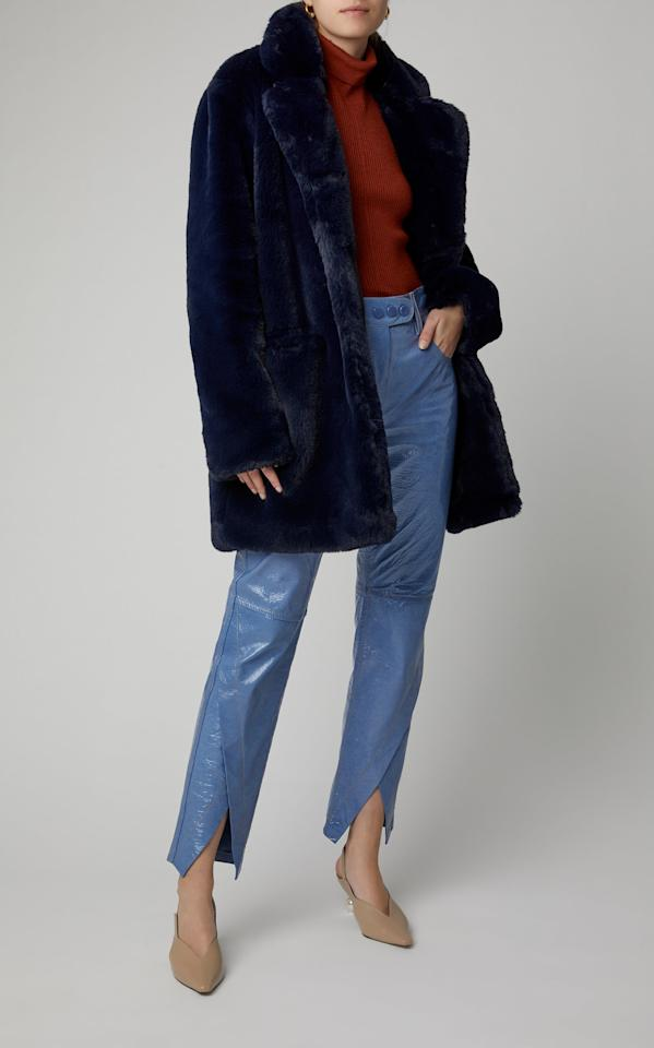 "<p>This cute <a href=""https://www.popsugar.com/buy/Apparis-Sophie-Faux-Fur-Coat-537507?p_name=Apparis%20Sophie%20Faux%20Fur%20Coat&retailer=modaoperandi.com&pid=537507&price=325&evar1=fab%3Aus&evar9=45621663&evar98=https%3A%2F%2Fwww.popsugar.com%2Ffashion%2Fphoto-gallery%2F45621663%2Fimage%2F47075843%2FApparis-Sophie-Faux-Fur-Coat&list1=shopping%2Cfall%20fashion%2Ccoats%2Cfall%2Cwinter%2Cwinter%20fashion%2Cbest%20of%202020&prop13=mobile&pdata=1"" rel=""nofollow"" data-shoppable-link=""1"" target=""_blank"" class=""ga-track"" data-ga-category=""Related"" data-ga-label=""https://www.modaoperandi.com/apparis-fw19/sophie-faux-fur-coat?color=navy"" data-ga-action=""In-Line Links"">Apparis Sophie Faux Fur Coat</a> ($325) comes in so many colors, but we're partial to the luxe navy.</p>"