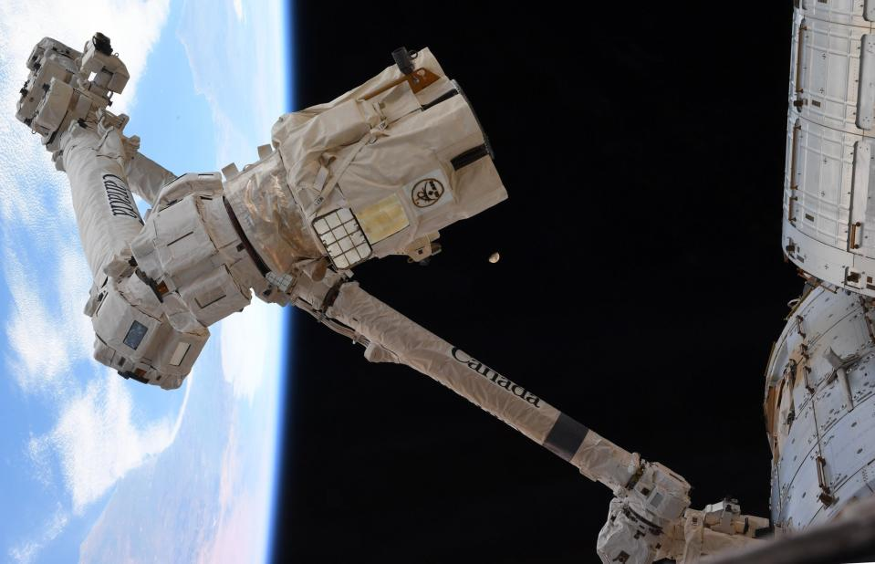 "The last quarter moon looms behind the International Space Station's Canadarm2 robotic arm in this photo by NASA astronaut Jessica Meir. She and her Expedition 62 crewmate Andrew Morgan used Canadarm2 to grapple an arriving Cygnus cargo spacecraft on Tuesday (Feb. 18). ""The mighty @csa_asc #Canadarm2 ready to grapple, as @AstroDrewMorgan & I practiced our maneuvers to capture #Cygnus that is headed our way, loaded with nearly 7,500 pounds of science, cargo, and @Space_Station supplies,"" Meir tweeted on Saturday (Feb. 15). ""Even the Moon made an appearance, awaiting #ARTEMIS eagerly,"" she added, referring to NASA's Artemis program, which aims to land astronauts on the moon in 2024."