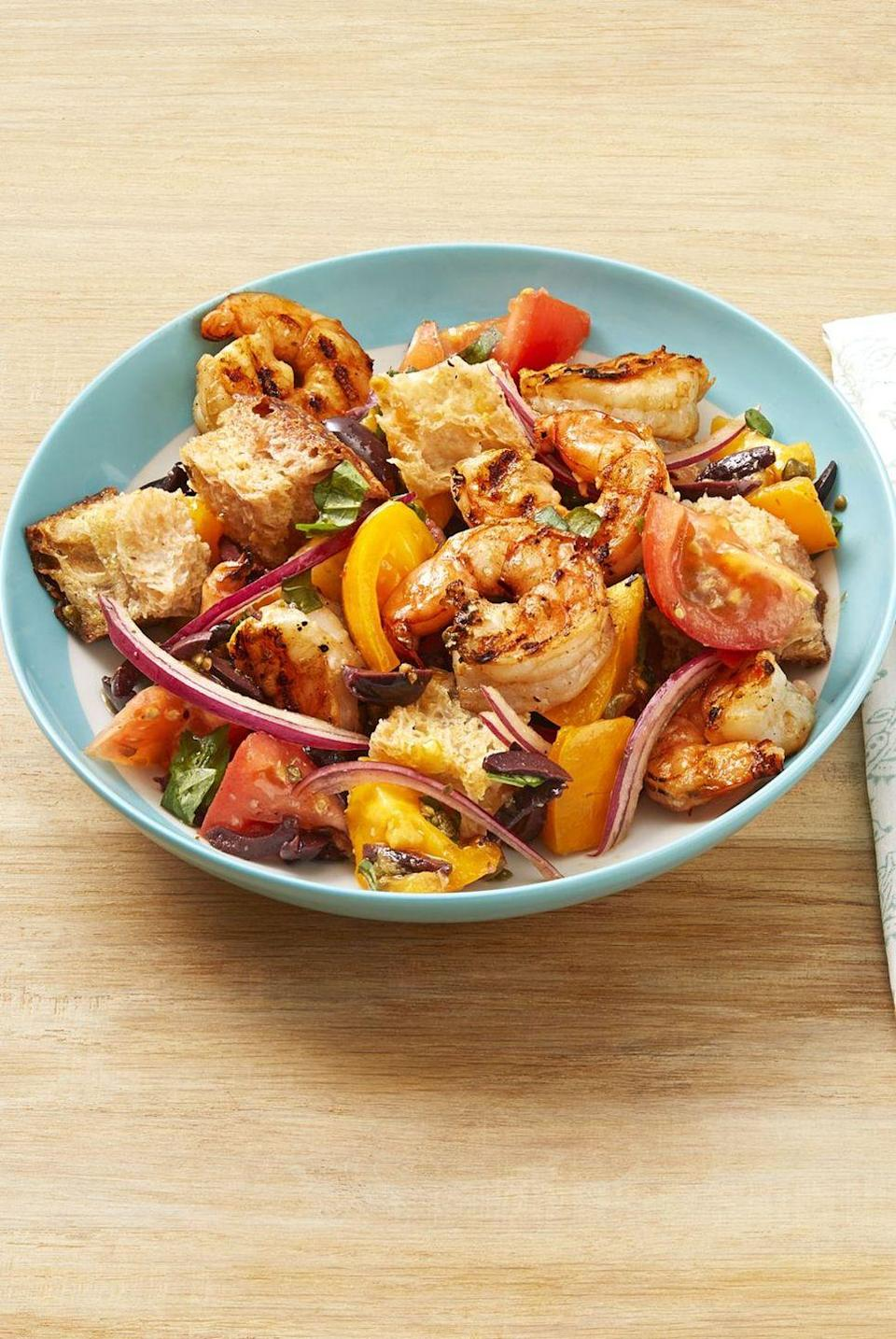 """<p>Once you try this panzanella salad, you'll never look at salad the same way again. With chunks of crusty bread, fresh tomatoes, and grilled shrimp, this flavorful dish will become a summer staple. </p><p><a href=""""https://www.thepioneerwoman.com/food-cooking/recipes/a32528706/grilled-shrimp-panzanella-recipe/"""" rel=""""nofollow noopener"""" target=""""_blank"""" data-ylk=""""slk:Get Ree's recipe."""" class=""""link rapid-noclick-resp""""><strong>Get Ree's recipe. </strong></a></p><p><a class=""""link rapid-noclick-resp"""" href=""""https://go.redirectingat.com?id=74968X1596630&url=https%3A%2F%2Fwww.walmart.com%2Fsearch%2F%3Fquery%3Dpioneer%2Bwoman%2Bsalad%2Bbowls&sref=https%3A%2F%2Fwww.thepioneerwoman.com%2Ffood-cooking%2Fmeals-menus%2Fg36500577%2Ftomato-recipes%2F"""" rel=""""nofollow noopener"""" target=""""_blank"""" data-ylk=""""slk:SHOP SALAD BOWLS"""">SHOP SALAD BOWLS</a></p>"""