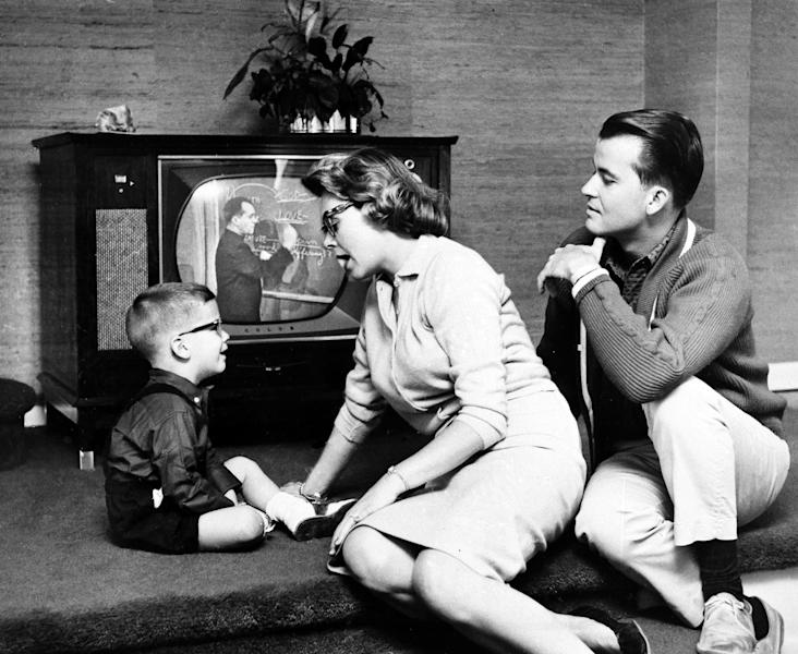 "FILE - This July 26, 1960 file photo shows Dick Clark and Barbara Mallery with their son, Richard, 3, in their home near Philadelphia. Clark, the ever-youthful television host and tireless entrepreneur who helped bring rock `n' roll into the mainstream on ""American Bandstand,"" and later produced and hosted a vast range of programming from game shows to the New Year's Eve countdown from Times Square, died of a heart attack on Wednesday, April 18, 2012. He was 82. (AP Photo, file)"