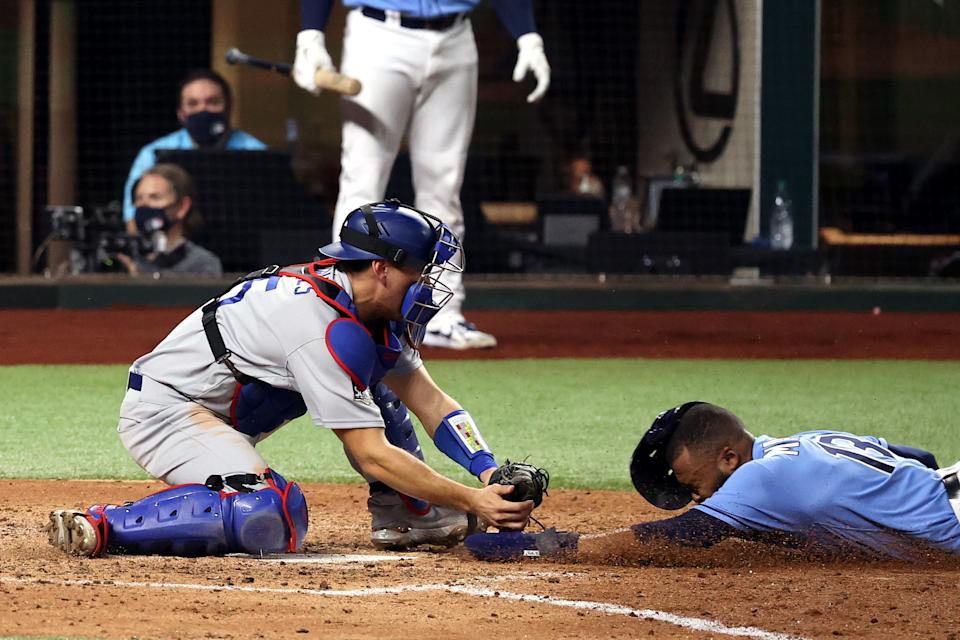 Manuel Margot #13 of the Tampa Bay Rays is tagged out by Austin Barnes #15 of the Los Angeles Dodgers on an attempt to steal home during the fourth inning in Game Five of the 2020 MLB World Series at Globe Life Field on October 25, 2020 in Arlington, Texas. (Photo by Rob Carr/Getty Images)