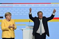German Chancellor Angela Merkel gave her backing to would-be successor Armin Laschet ahead of elections next month