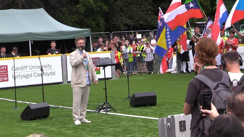 Michael Sheen delivers an address at the opening of the 2019 Homeless World Cup in Cardiff, Wales (Credit: