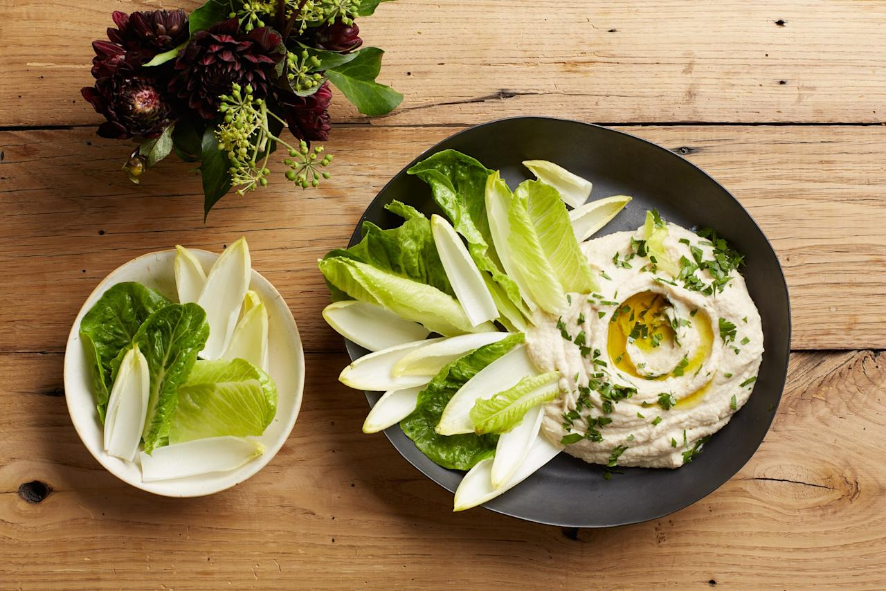 """Earthy and rich, this creamy dip will add a little variety to all of the cheese-laden dips in your Super Bowl spread. Serve with romaine hearts or endives for dipping. <a href=""""https://www.epicurious.com/recipes/food/views/creamy-cauliflower-dip?mbid=synd_yahoo_rss"""">See recipe.</a>"""