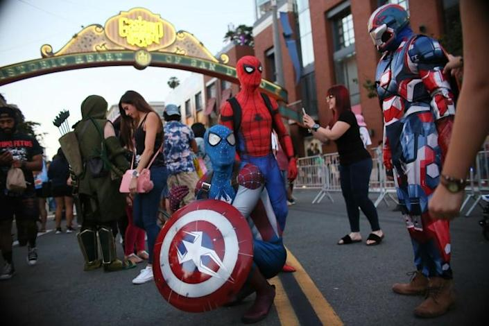 What was once an intimate event now sees thousands of bleary-eyed fans -- dressed in pitch-perfect monster, alien and manga costumes -- lining up long before dawn to squeeze into packed events. (AFP Photo/Sandy Huffaker)