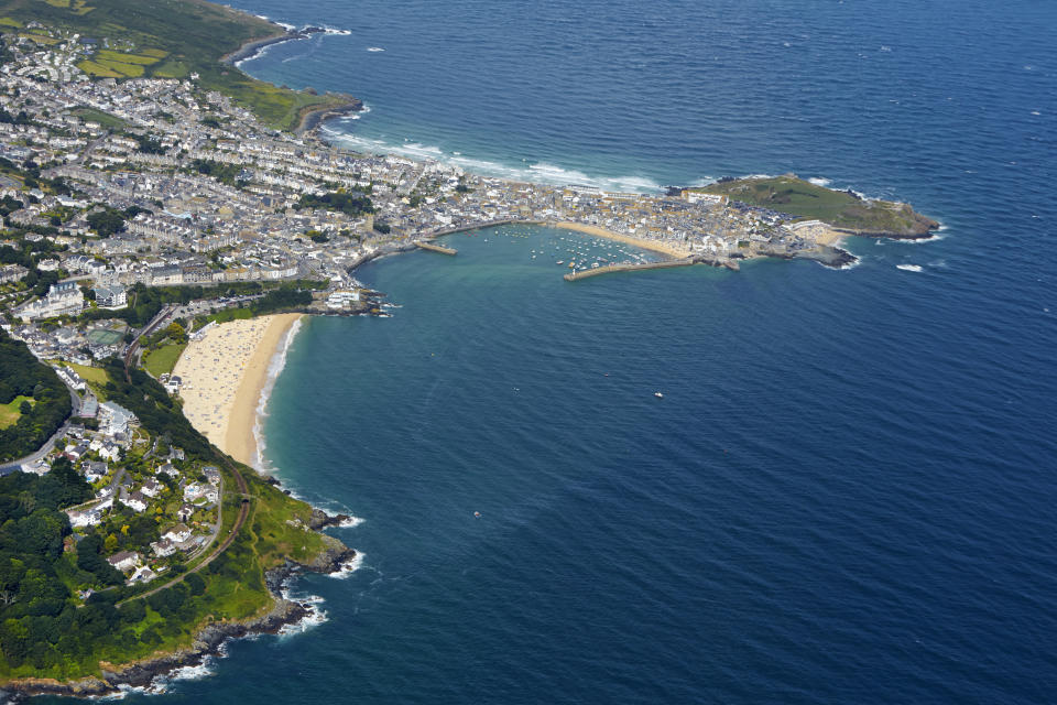 Aerial view of the popular seaside port and resort of St Ives and Carbis Bay.