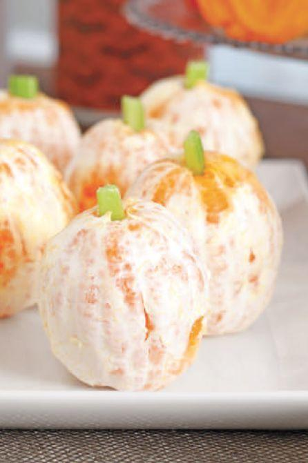 """<p>For a healthier party snack that still celebrates the holiday, peel several oranges and use celery to create a pumpkin stem.</p><p><em><a href=""""https://www.womansday.com/food-recipes/food-drinks/a28834259/tangy-pumpkins-recipe/"""" rel=""""nofollow noopener"""" target=""""_blank"""" data-ylk=""""slk:Get the Tangy Pumpkins recipe."""" class=""""link rapid-noclick-resp"""">Get the Tangy Pumpkins recipe.</a></em></p>"""