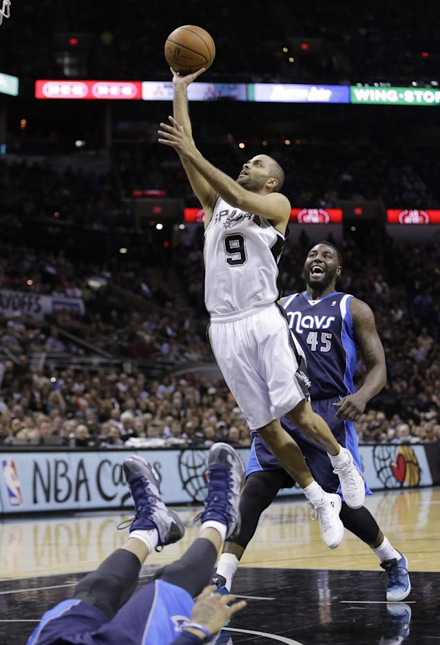 San Antonio Spurs' Tony Parker (9), of France, shoots over a falling Dallas Mavericks' Monta Ellis, left, as Mavericks' DeJuan Blair (45) looks on during the first half of Game 2 of the opening-round NBA basketball playoff series, Wednesday, April 23, 2014, in San Antonio. Parker was called for charging on the play. (AP Photo/Eric Gay)