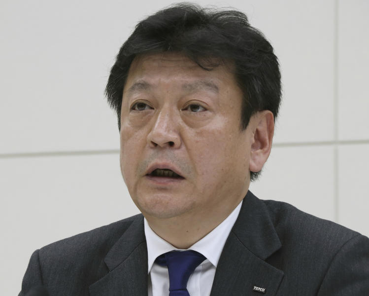 FILE - In this April 3, 2017, file photo, Tokyo Electric Power Co. (TEPCO) President Tomoaki Kobayakawa speaks during a press conference at its headquarters in Tokyo. The operator of the nuclear plant wrecked by a tsunami is considering decommissioning more reactors in northeastern Japan. Tokyo Electric Power Company Holdings says a decision is pending on dismantling the four reactors at the Fukushima Dai-ni plant. TEPCO President Kobayakawa is set to brief Fukushima prefectural and town officials on Wednesday, July 24, 2019, but the company did not give further details.(AP Photo/Koji Sasahara, File)