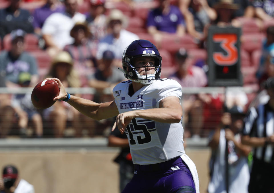 Northwestern quarterback Hunter Johnson (15) throws a pass against Stanford in the first quarter of an NCAA college football game in Stanford, Calif., Saturday, Aug. 31, 2019. (AP Photo/Josie Lepe)