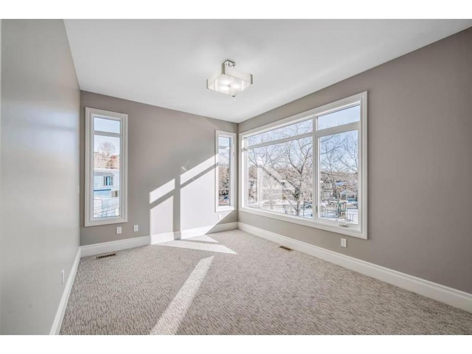 <p><span>616 3 Avenue Northwest, Calgary, Alta.</span><br> There are three bedrooms in the home (two on the upper level, one on the main level), including a master suite with its own private balcony.<br> (Photo: Zoocasa) </p>